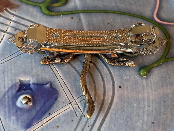 Blue dragonfly brooch underneath