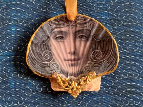 Portrait of a woman scallop shell ornament